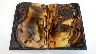 Untitled, 2016, burnt book sculpture, 36 x 61 x 16 cm. Image courtesy Garo Bardakjian